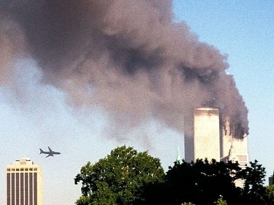 A plane approaches New York's World Trade Center moments before it struck the tower at left, as seen from downtown Brooklyn on Sept. 11, 2001.