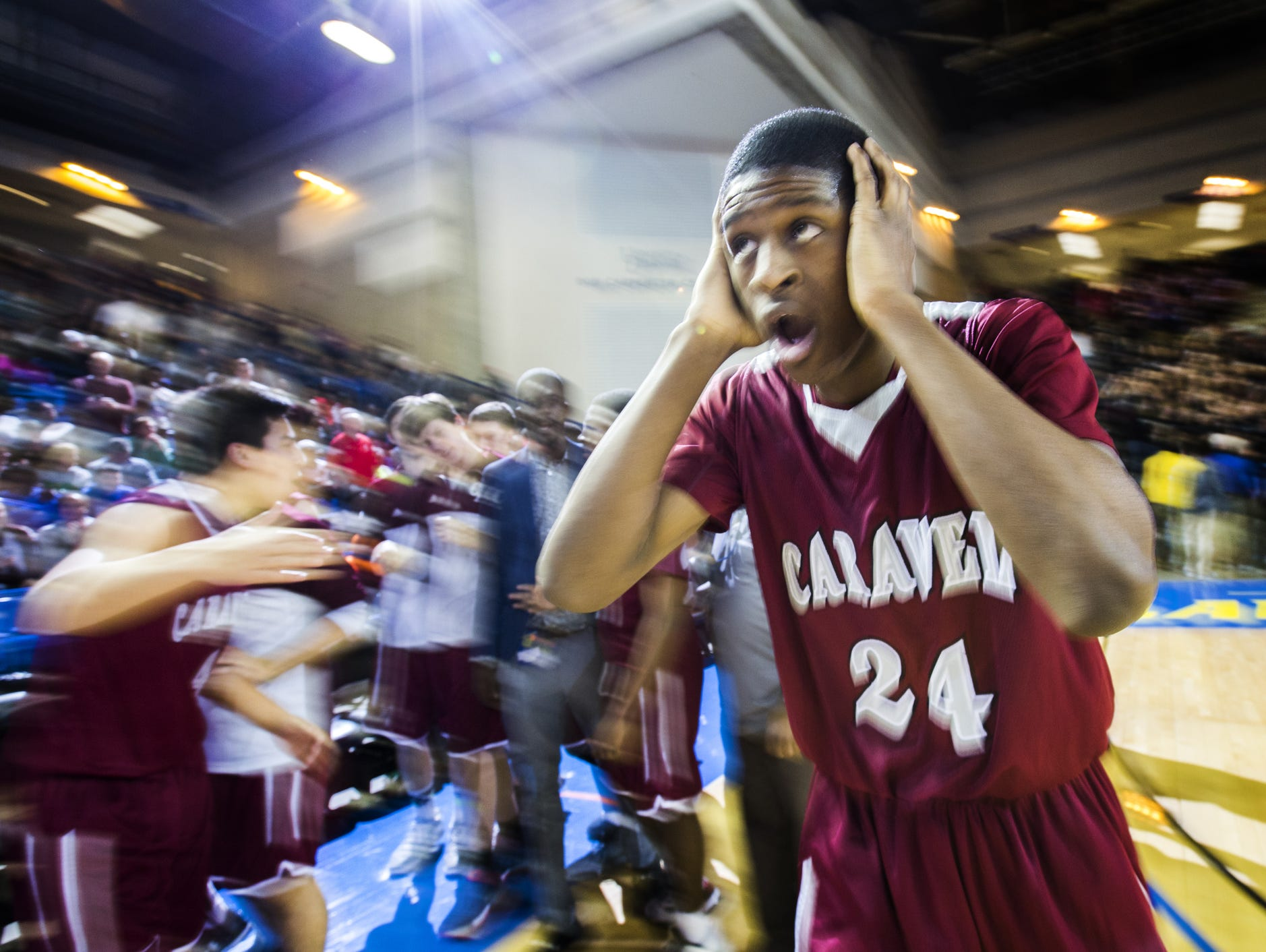 Caravel's O'Koye Parker reacts as his teammates celebrate the Bucs' 48-47 semifinal win over St. Thomas More in the DIAA Boys Basketball Tournament on Thursday. Parker hit the winning free throw with 2.4 seconds remaining.