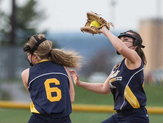 Elco's Sarah Yermalovich, right, hauls in a pop fly.