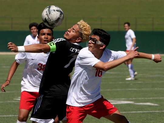 Wichita Falls High School's Alex Ramirez heads the ball next to El Paso Bel Air's Anthony Maese in the Region I-5A quarterfinal Friday, April 7, 2017, in Wichita Falls Memorial Stadium. The Coyotes defeated the Highlanders 2-1 on penalty kicks.
