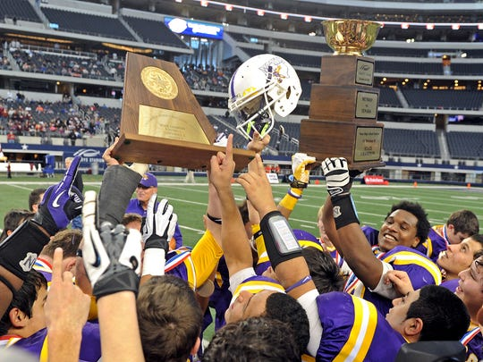 Munday celebrates their 42-14 win over Tenaha in the Class A Div. II State Finals at Cowboys Stadium Thursday afternoon.