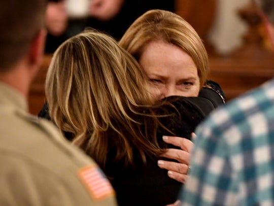 Karen Bobo gives a hug to State prosecutor Jennifer
