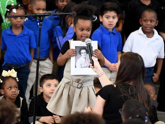 Alexander Elementary School student Khloe Ewell pays