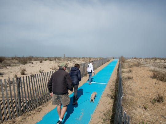 A view of the blue mats leading up to the beach on