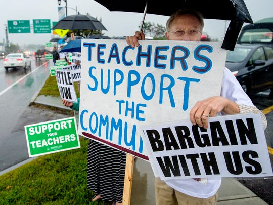 More than 100 members of the Burlington Education Association, the union that represents Burlington teachers, and their supporters join an informational picket in front of Staples Plaza on Williston Road in Burlington on Tuesday, September 5, 2017.  The Burlington School Board recently imposed a contract on teachers.