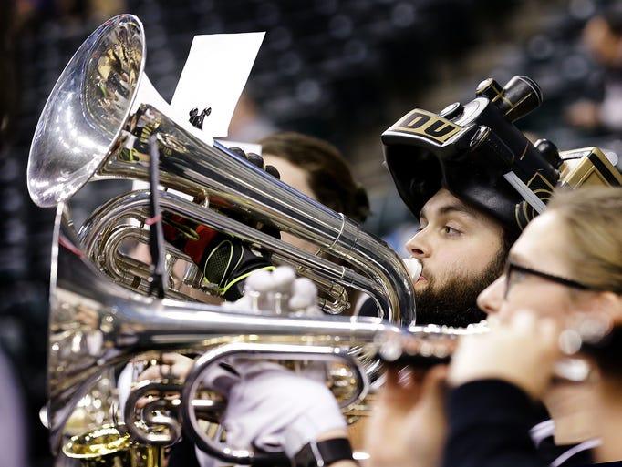 Purdue baritone pep band member Sam Rose plays along
