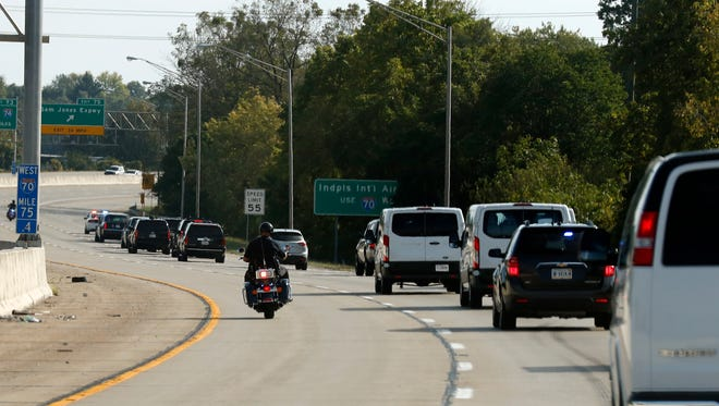 Law enforcement officers on motorcycles escort the motorcade of President Donald Trump en route to Air Force One, Wednesday, Sept. 27, 2017, in Indianapolis.