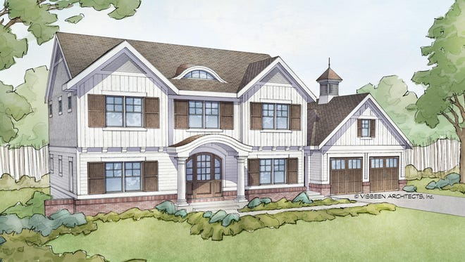 With appealingly symmetrical windows and gables, an eyebrow dormer, and even a cupola above the garage, this design brings classic charm to the neighborhood.