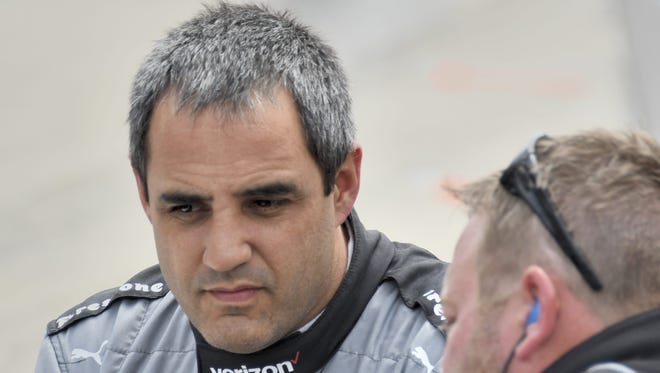 FILE --  Juan Pablo Montoya takes a close look at early changes to his car on opening day of practice at the Indianapolis Motor Speedway on May 16, 2016.