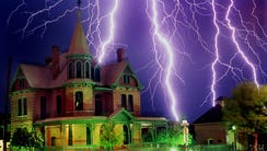 Lightning strikes over the historic Rosson House in