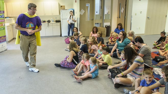 """Dan Wardell of IPTV """"Kids Clubhouse"""" entertained and informed children and their parents July 8 and the Altoona library. As part of his program, Wardell encouraged children to turn off their television and go outside to play."""