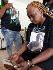 Jamychael Mitchell's mother, Sonia Adams, sits surrounded