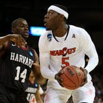 Cincinnati Forward Justin Jackson (5) looks to shoot against Harvard Forward Steve Moundou-Missi (14) in the first half of their NCAA tournament game this month.