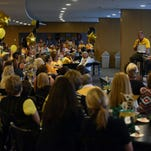 Southern Miss head football coach Jay Hopson answers questions from John Cox during the Football 101 Chalk Talk for Women event on Tuesday at Southern Miss' Touchdown Terrace in  M.M. Roberts Stadium.