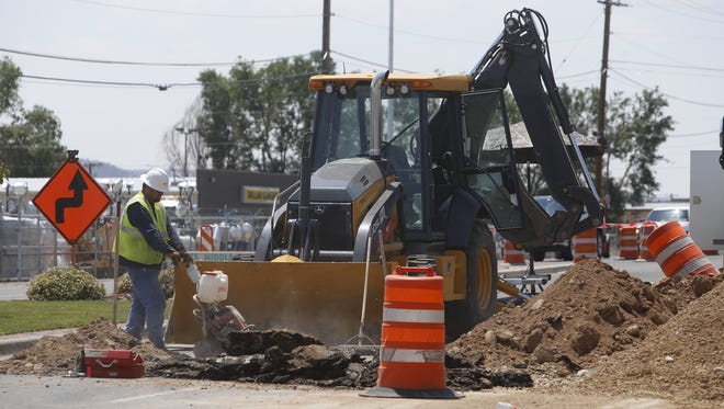 A city of Farmington employee works near a gas line break in the westbound lanes of the Bloomfield Highway between Riverstone Road and Don Rovin Lane on Thursday.