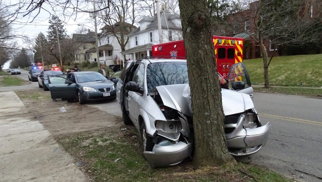 The driver of a 2001 Dodge Caravan was taken to the hospital after crashing into a tree on West Third Street Tuesday evening. The minivan had been pursued by a 2006 Pontiac G6.