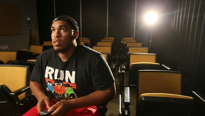 Iowa defensive lineman Carl Davis reviews film on Monday, July 21, 2014, inside the University of Iowa football offices inside the Recreation Building on campus in Iowa City, Iowa.
