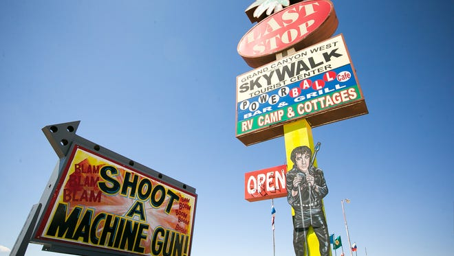 Signs advertise the shooting range at Bullets and Burgers in White Hills, Ariz., on Aug. 27, 2014.