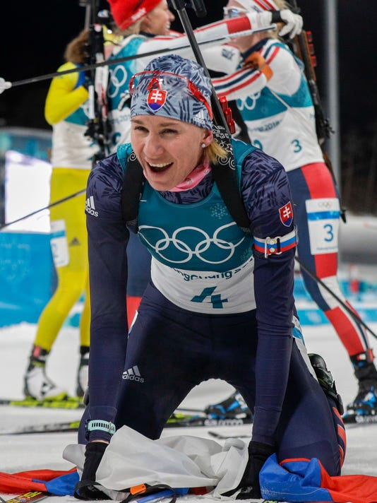 Anastasiya Kuzmina, of Slovakia, catches her breath in the finish area after winning the women's 12.5-kilometer mass start biathlon at the 2018 Winter Olympics in Pyeongchang, South Korea, Saturday, Feb. 17, 2018. (AP Photo/Gregorio Borgia)