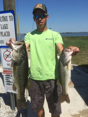 Kolin Ashbacher holding up a couple of his tournament winning Lake Placid Largemouth Black Bass. Kolin won the tournament and received Big Bass Honors with the bass on the left, weighing (7.77 lbs.). All the bass were released alive.