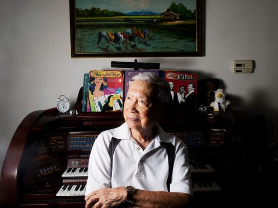 Pancho Mauricio, 99, sits for a portrait at his Cape