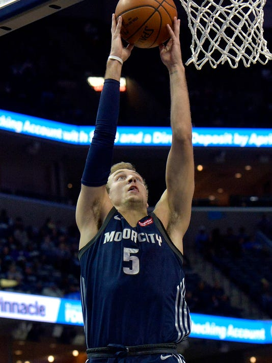 Detroit Pistons guard Luke Kennard (5) shoots in the first half of an NBA basketball game against the Memphis Grizzlies Sunday, April 8, 2018, in Memphis, Tenn. (AP Photo/Brandon Dill)