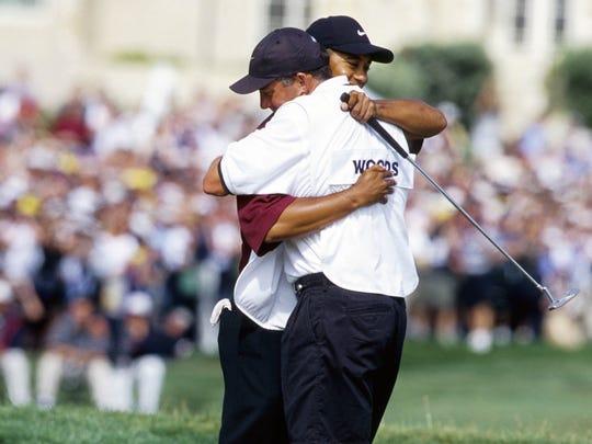 Jun 18, 2000; Pebble Beach, CA, USA; FILE PHOTO; Tiger Woods hugs caddie Steve Williams after winning the 2000 US Open Championship at Pebble Beach Golf Links. Mandatory Credit: Brian Spurlock-USA TODAY Sports