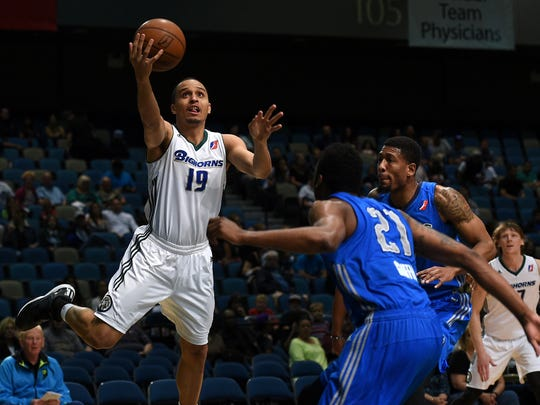 Reno Bighorns guard Reggie Hearn drives against Texas Legends' Eric Griffin (21) at the Reno Events Center in Reno, Nev. on March 28, 2015.