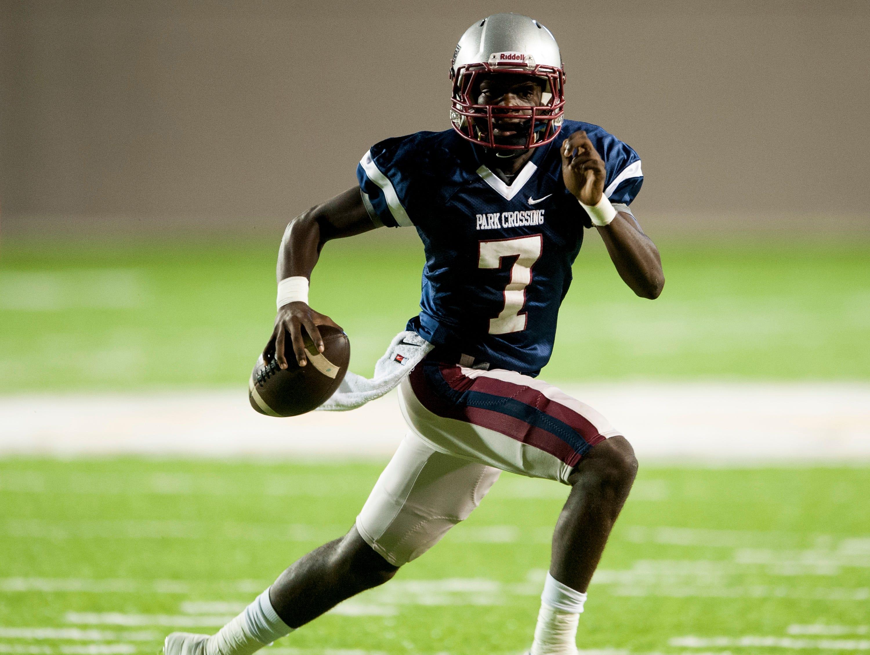 Park Crossing quarterback Malik Cunningham runs against Wetumpka at Cramton Bowl in Montgomery, Ala. on Friday September 11, 2015.