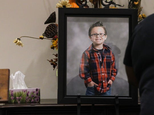 A framed photograph of Jacob Hall near a box of tissues in the lobby of the church, during the funeral service for him on Oct. 4 at Oakdale Baptist Church in Townville.