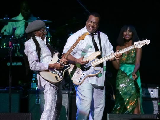 Guitarist/composer Nile Rodgers, left, and bassist