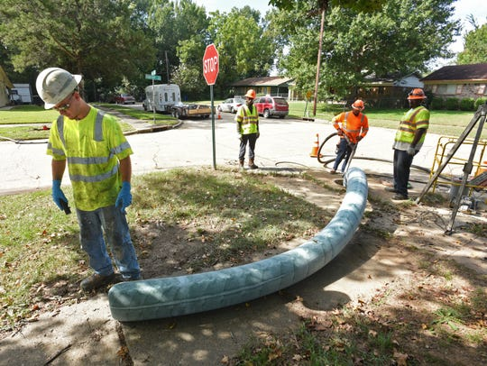 New resin pipe liner emerges from an old sewer line
