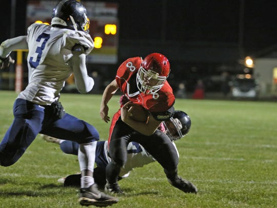 Riverheads' Zac Smiley breaks a tackle on his way to