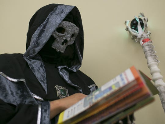 Gus Martinez is dressed as a necromancer at Phoenix Comic Fest on Thursday, May 24, 2018 in Phoenix, Ariz.
