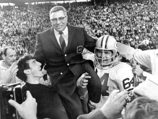 FILE-This Jan. 14, 1968 file photo shows Green Bay Packers coach Vince Lombardi  being carried off the field after his team defeated the Oakland Raiders 33-14 in Super Bowl II  in Miami, Fla.  Packers guard Jerry Kramer (64) is at right.