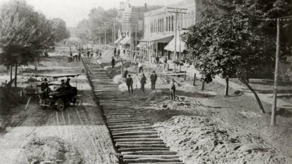 Workmen place rail ties on Saline Street, in downtown Petersburg, about 1905, for the electric interurban system.