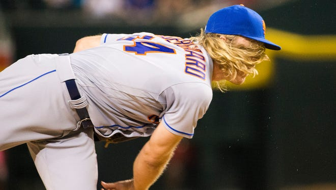 New York Mets pitcher Noah Syndergaard throws against the Arizona Diamondbacks during the first inning at Chase Field in Phoenix August 16, 2016.