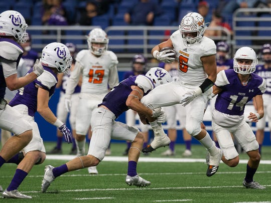 Refugio's Ysidro Mascorro is brought down by Mason's Jake Cockerham during the third quarter of the Class 2A Division I state quarterfinal at the Alamodome in San Antonio on Friday, Dec. 8, 2017.