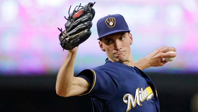 Brewers starting pitcher Brent Suter throws to a Seattle Mariners batter.