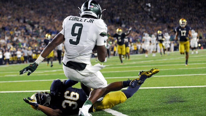 Michigan State University freshman receiver Donnie Corley (9) fights for the ball in the air with Notre Dame's Cole Luke (36) in the endzone in the first half of the Spartans game against Notre Dame Saturday, Sept. 17, 2016 in South Bend, Ind. Corely caught the ball and scored MSU's first touchdown of the game.