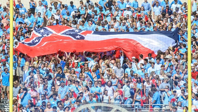 Mississippi's state flag is unfurled at the Ole Miss vs. Alabama game at Vaught-Hemingway Stadium in Oxford on Sept. 17.