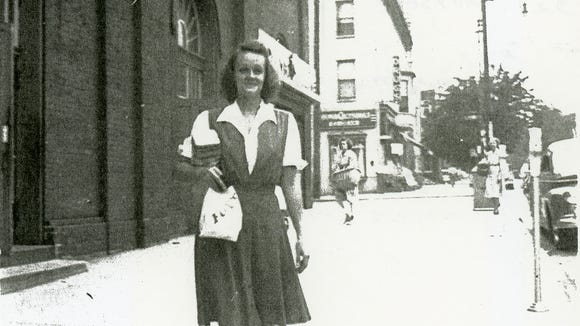 "Years passed and the market prospered. Here's a typical scene. Jean Fix shared this photo of her mother, Anna Oberdick Myers, taken in about 1943 as she was leaving Farmers' Market in York. Jean wrote, ""I'll bet that bag contained poppy seed rolls as they went with our weekly 'Farmers Market' supper. With the rolls, would be ham, cole slaw, potato salad and sugar cakes for dessert. What a nice memory!"""