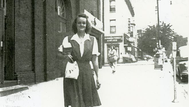 """Years passed and the market prospered. Here's a typical scene. Jean Fix shared this photo of her mother, Anna Oberdick Myers, taken in about 1943 as she was leaving Farmers' Market in York. Jean wrote, """"I'll bet that bag contained poppy seed rolls as they went with our weekly 'Farmers Market' supper. With the rolls, would be ham, cole slaw, potato salad and sugar cakes for dessert. What a nice memory!"""""""