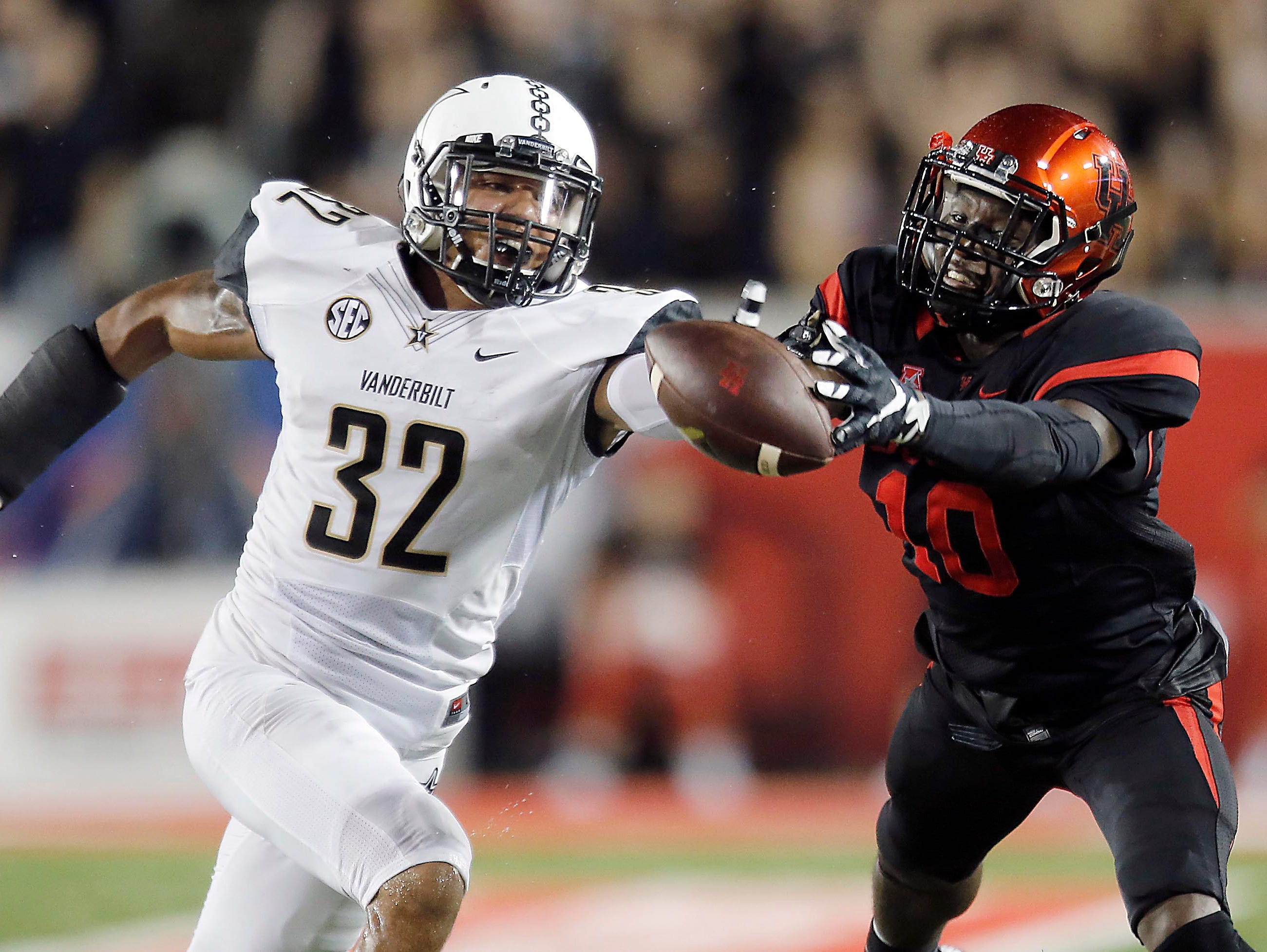 Vanderbilt safety Andrew Williamson (32) breaks up a a pass intended for Houston wide receiver Demarcus Ayers (10) in the first quarter on Oct. 31, 2015.