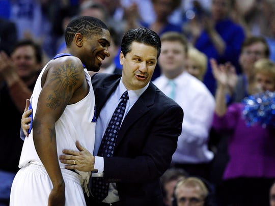 February 20, 2007 - Memphis' Jeremy Hunt, left, is congratulated by head coach John Calipari, right, after he scored his 1000th career point against Rice.