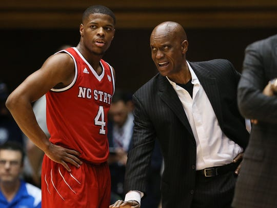 North Carolina State assistant coach Butch Pierre talks with guard Dennis Smith Jr. (4) during a game against Duke on Jan. 23, 2017.