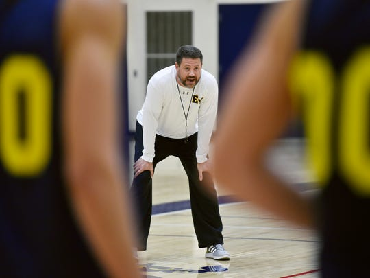 Head coach Bill Reichard watches a drill during basketball practice Friday, Nov. 18, 2016, at Eastern York.