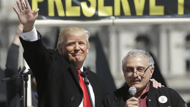 Donald Trump, left, and Carl Paladino, who ran for governor of New York as a Republican in 2010, speak during a gun rights rally at the Empire State Plaza on April 1, 2014.