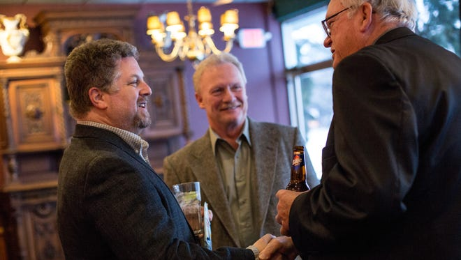 Jeff Katofsky, the new owner of the St. Clair Inn, left, shakes hands with St. Clair Downtown Development Authority chairman Paul Wade during a meet and greet Wednesday, Feb. 10, 2016 at The Voyageur in St. Clair.