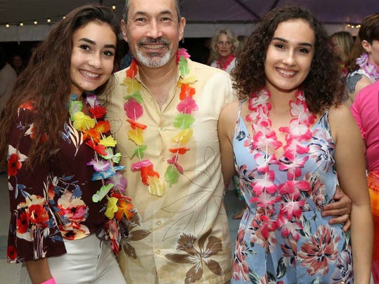 Esabella Castrillo, left, Ademil Castrillo and Amelia Castrillo were among more than 200 people clad in island attire at United Way of Martin County's inaugural Tikis on the Terrace, presented by All About Achieving Learning Centers.